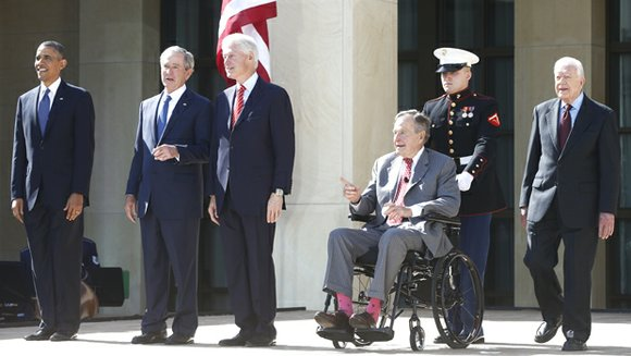 George W. Bush marked his unofficial return to the public eye at the dedication of his presidential library, basking in ...