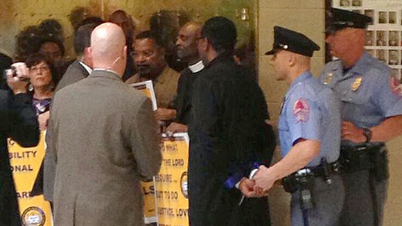 Seventeen people, including eight ministers, civil rights leaders and students, were arrested for a prayerful protest at the state Legislature ...