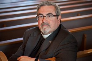 For more than two decades, the Rev. R. Guy Erwin couldn't officially be a priest in the Evangelical Lutheran Church ...