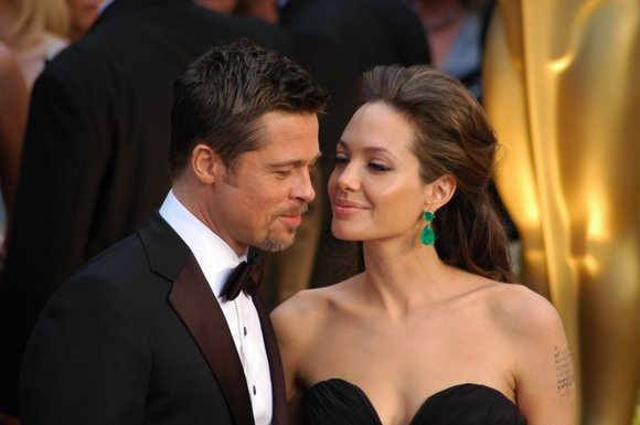 Angelina Jolie may not have been by Brad Pitt's side, but she was certainly on his mind.