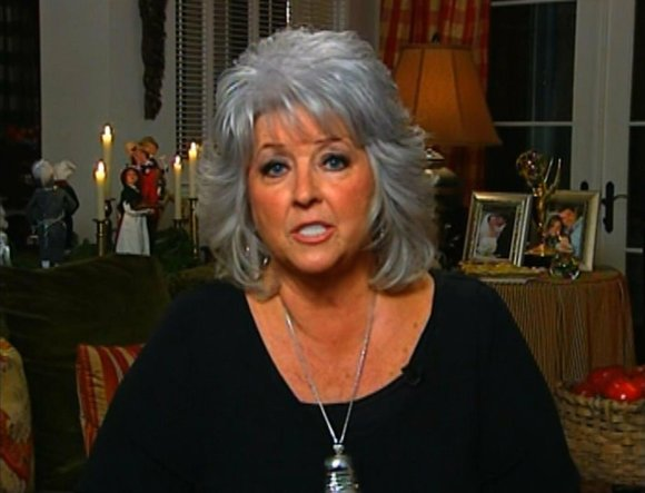 "Celebrity chef Paula Deen's sons staunchly defended their mother Tuesday, saying allegations of racism are false ""character assassination."""