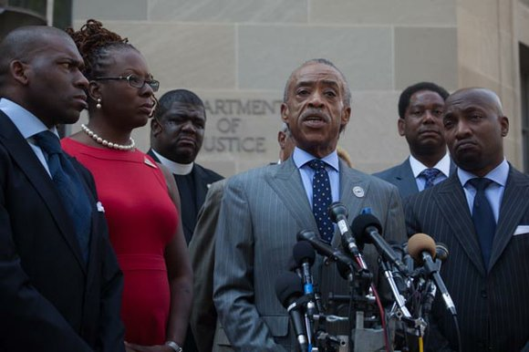 Rev. Al Sharpton held a press conference Tuesday in front of the U.S. Justice Department with more than 25 ministers, ...