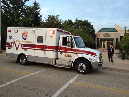 Paramedics wheeled Joliet City Councilwoman Susan Barber (4th District) out of city hall in a stretcher and into an ambulance ...