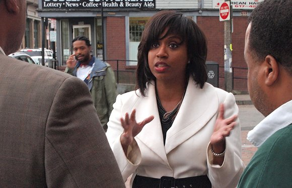 In 10 minutes on a sidewalk in Dudley Square, City Councilor At-Large Ayanna Pressley engages in a series of conversations ...