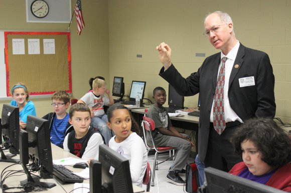 U.S. Rep. Bill Foster makes a point during a discussion with an honors language arts class at Lukancic Middle School ...