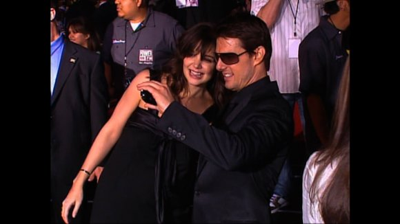 "Tom Cruise is defending his relationship with daughter Suri, denying that she felt ""abandoned"" last summer when he was divorcing ..."