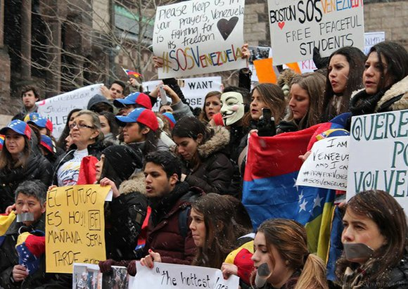 Twice in the last two weeks, Venezuelan national Cristina Aguilera has taken to the streets of Boston to show support ...
