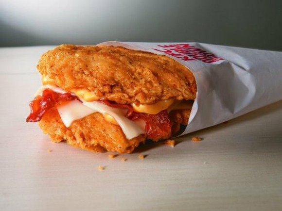 KFC is bringing back the Double Down, a bacon and cheese sandwich that uses two fried chicken filets as a ...