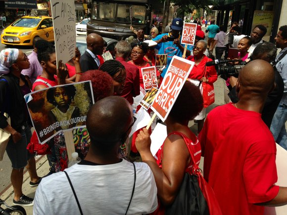 Nigerians and Americans of all ages stood in front of the Nigeria house in Manhattan with signs that said 'Bring ...