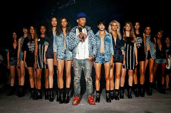 Designers usually wait to show their faces after the models hit the runway. Not Pharrell.