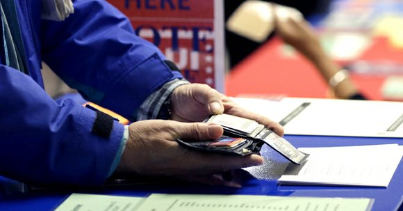 A federal judge likened Texas' tough voter ID rules to a poll tax meant to suppress minority voters on Oct. ...