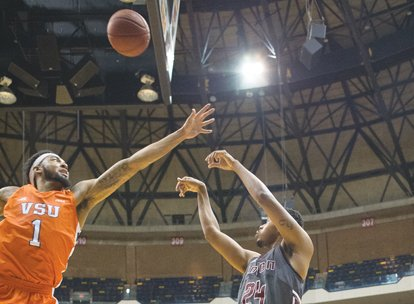 Virginia State University's front line measures 6-foot-10, 6-foot-8 and 6-foot-8. The Trojans stand tall in the CIAA standings as well. ...