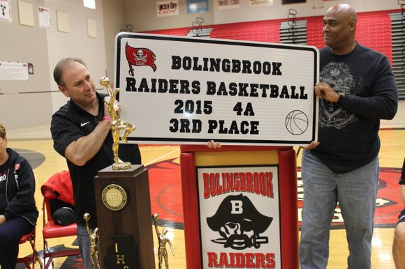 VVSD School Board President Steve Quigley and Superintendent Dr. James Mitchem unveil the latest Bolingbrook High School state finals sign ...