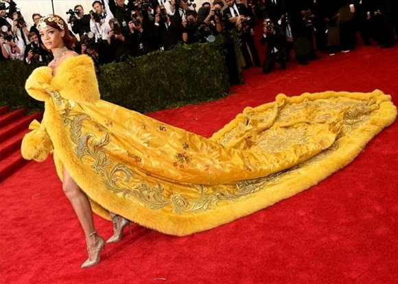Rihanna shut down the Met Gala's red carpet in a regal yellow coat. And then came Bey.