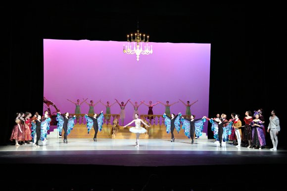 Sumptuous and colorful costumes depict the fairy godmother and fairies transforming Cinderella's rags to the grand ball gown when she ...