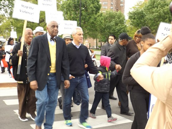 Chicago Mayor Rahm Emanuel joined community groups and residents who packed Metropolitan Apostolic Community Church at 4100 S. Dr. Martin ...
