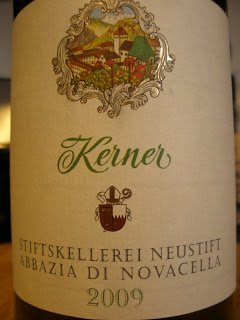 Along the steep slopes of the Italian Alps, about 2000 feet above sea level grows the Kerner grape, a modern ...