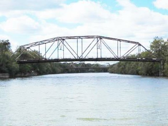 Ill. State Rep. Rita led an event Tuesday evening that outlined the a timeline for the Division Street Bridge in ...