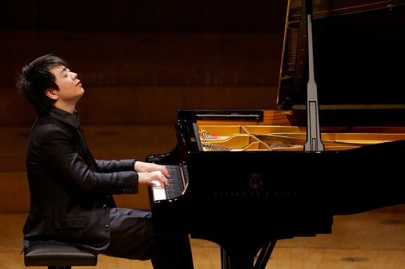 NEW YORK--Piano megastar Lang Lang is known for his glitz at the piano, sometimes with acrobatics bordering on an Elton ...