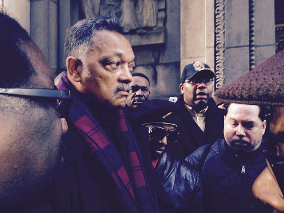 The Rev. Jesse Jackson, Sr. and dozens of others marched 16 times around Chicago's city hall on Dec. 4 to ...