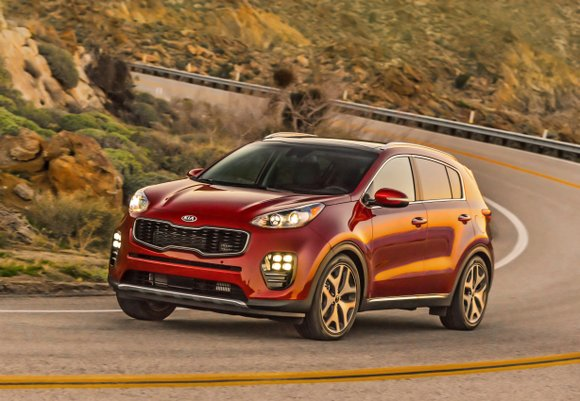 The new Kia Sportage was a little bit longer and the wheels were pushed to the corners. The tiger nose ...