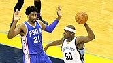 Zach Randolph draws defense from Philadelphia's  Joel Embiid. Z-bo finished with 17 points and 8 rebounds. (Photo: Warren Roseborough)