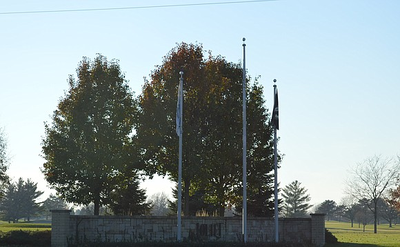 Flag pole monuments scattered around the city of Joliet will be illuminated soon thanks to the perseverance of some dedicated ...