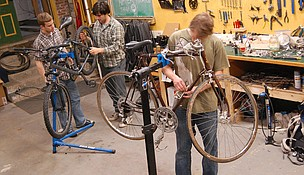 Middlebury College students who complete a free class on bicycle repair are rewarded with a free discarded bike. Credit: Robert Keren.