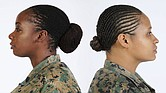 In January, the United States Army changed its regulations to allow women to wear their hair in twisted locks. The Marine Corps, above, approved lock and twist hairstyles in late 2015. (Photo: Marine Corps)