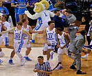 The Tar Heels jump and shout in a happy dance after the buzzer sounds on a thriller of a final in the South Regionals in Memphis. (Photo: Karanja A. Ajanaku)