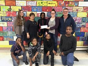 Joliet Junior College students presented a $550 donation this month to the Warren Sharpe Community Center using proceeds from a ...