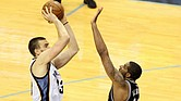 With the Spurs' LaMarcus Aldridge tightly contesting the shot, Marc Gasol nails the game winner for the Grizzlies, sending the series back to San Antonio even at two games each. (Photo: Warren Roseborough)