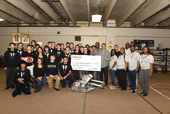 Amazon surprised members of the Cyborgs Robotics Team in Joliet with a $5,000 donation.