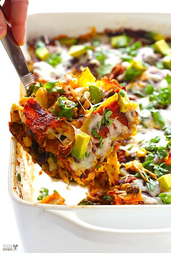 SERVINGS: 8 INGREDIENTS: 3 cups red enchilada sauce 16 corn tortillas, halved 2 (15 ounce) cans black beans, rinsed and ...