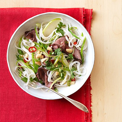 SERVES: 4 / TOTAL TIME: 0:20 INGREDIENTS • 8 oz. rice noodles • ¼ c. canola oil • 2 tbsp. ...