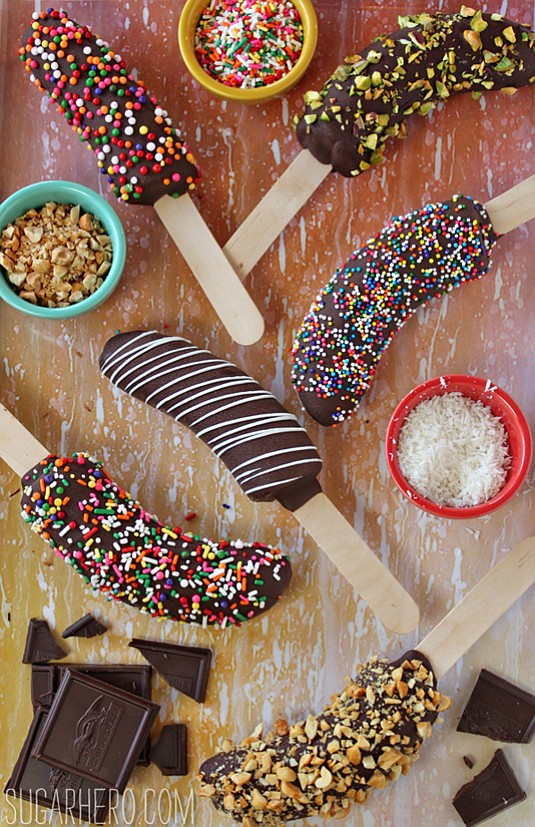 yield: 10 frozen bananas INGREDIENTS: 5 large bananas 10 wooden sticks 24 ounces semi-sweet chocolate, coarsely chopped Assorted toppings: sprinkles, ...