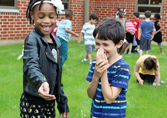 (From left) Plainfield Central Elementary School first graders Kayla Ashmon and Ricky Berger react to the butterfly on Ashmon's arm ...