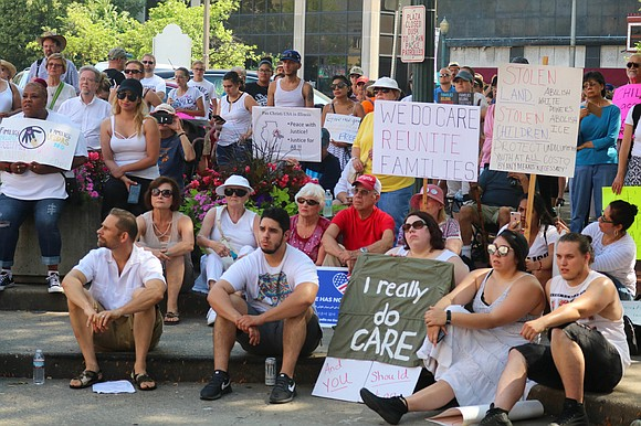 People gathered Saturday at Chicago Street Plaza in Joliet to protest the separation of families at the U.S.-Mexico border. The ...