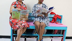 (From left) Michelle Monroe, a first grade teacher at Elizabeth Eichelberger Elementary School and Charmelle Mallory, a first grade teacher at Meadowview Elementary School, members of the United Way of Will County's Women United social change project Read to Succeed opened its first my Little Free Library on August 1, 2018 at Fairmont Elementary School in Lockport.
