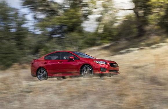 I was given the choice of test driving a Subaru Impreza equipped with either a continuously variable transmission or one ...