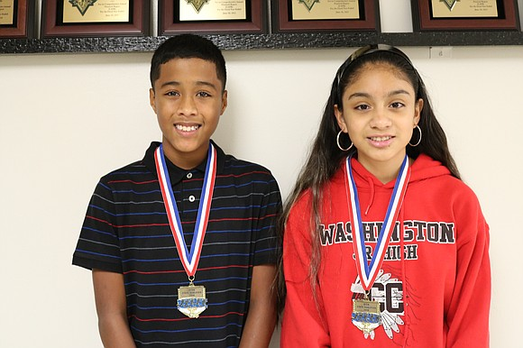 Washington Junior High seventh grade students (from left to right) Marcellus Mines and Arely Reynoso competed in the Illinois Elementary ...