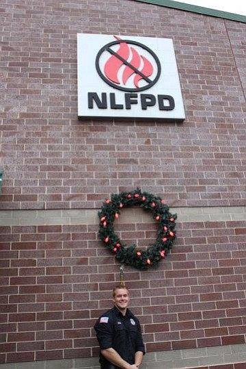 The New Lenox Fire Protection District's (NLFPD) four fire stations will have a large wreath on the front of them ...