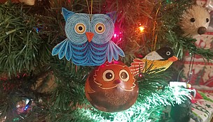 """Just in time for the holiday season, the Forest Preserve District of Will County's Plum Creek Nature Center has been stocked with a wide variety of """"green"""" and nature-themed gifts, including these adorable handmade ornaments from Servv, a company dedicated to fighting global poverty through fair trade. (Photo by Forest Preserve staff/Cindy Cain)"""
