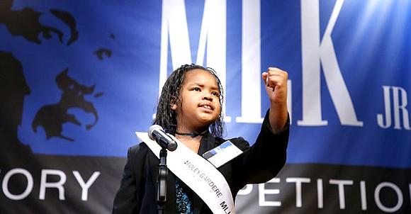 Honoring Dr. Martin Luther King Jr. by channeling his passion and charisma, 20 Texas elementary school students took part in ...