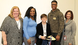 (From left to right) Joliet Public Schools District 86 Superintendent Dr. Theresa Rouse, Dirksen Junior High Principal Dr. Markisha Mitchell, Washington Junior High Principal Rolland Jasper, and Gompers Junior High Principal Rita Sparks congratulate Ryland Denson from Hufford Junior High on his double gold award.