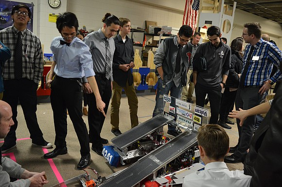 The Joliet Township High School Cyborgs Robotics Team unveiled its newest robot during the 7th Annual Community Exhibition on Thursday, ...