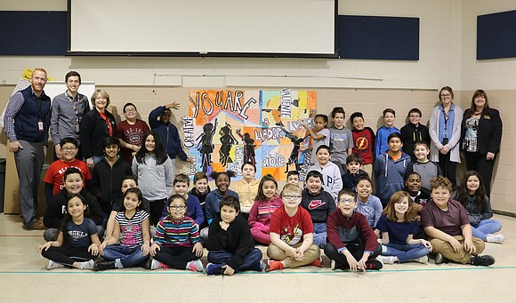 Joliet artist and Thomas Jefferson School parent Topher Gleason recently joined District 86 art teacher Angela Klunder at the elementary ...