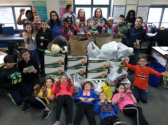 Walker's Grove Elementary School fifth graders in Karen Eiserman's class collected 30 boxes of gently used shoes, boots, soccer and ...