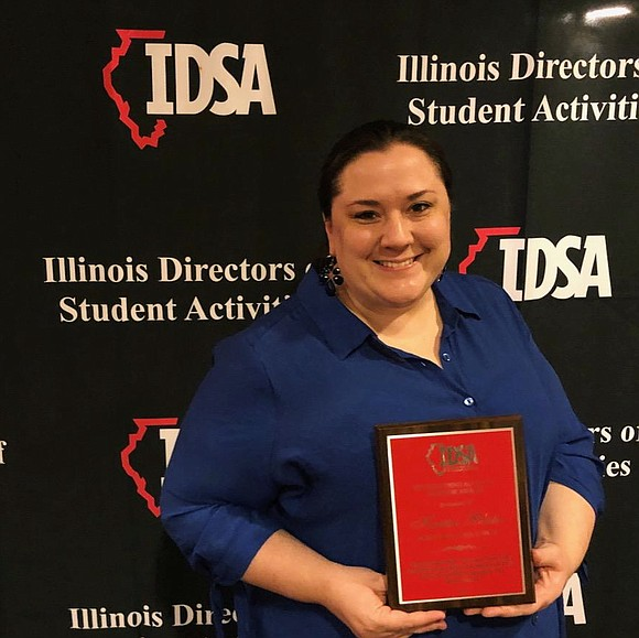 The Illinois Directors of Students Activities (IDSA) recently recognized Kristin Blake, Speech Team Head Coach from Joliet West High School, ...