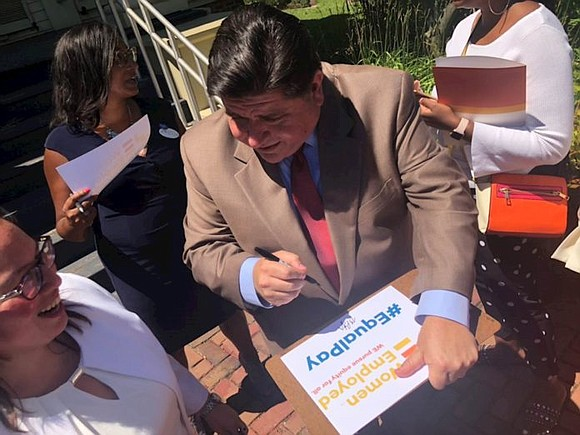 Gov. J.B. Pritzker signed bills into law Wednesday aimed at equalizing pay between men and women and expanding access to ...